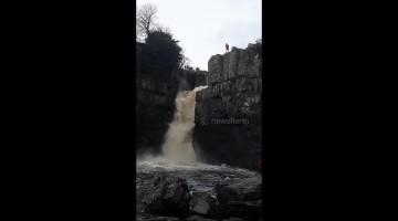 Adrenaline junkie flings self down waterfall during UK floods