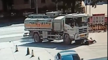 Scooter driver narrowly escapes being run over by truck