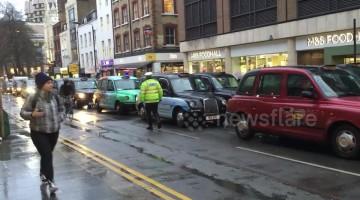 London cabbies block Tottenham Court Road over vehicle ban