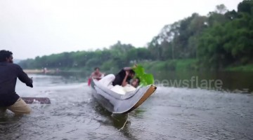 Indian couple end up falling into river trying to get perfect wedding photo