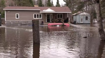 State of emergency in Ontario town as homes and sidewalks submerged