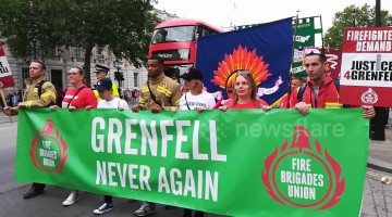 Marchers stream past Downing Street calling for justice for Grenfell