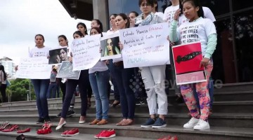 Bolivian activists place shoes outside court in protests at sexist killings