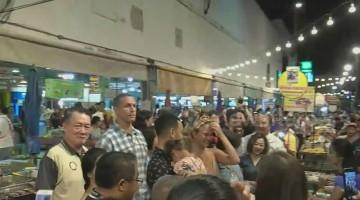 John Legend and Chrissy Teigen walk around Thai street food market