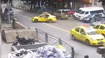 Taxi pulls out onto road in China seeing cyclist fly through its window