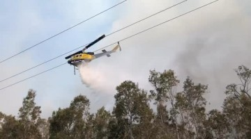 Helicopter Helps Extinguish Flames