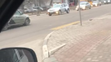 Taxi Takes Off with Passenger on the Hood