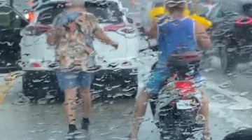 Older Lady Gives Motorcyclist Rain Coat During Storm