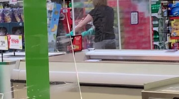 Lady Seen Shopping at Store in Portable Germ Bubble