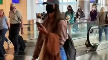 Little sister gets surprise visit at airport for her birthday weekend