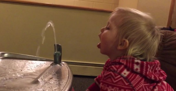 Cute Little Girl Can't Figure out Drinking Fountain
