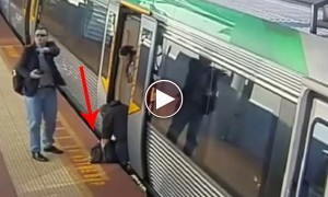 Amazing Video Of Commuters Pushing An Entire Train Aside To Help A Trapped Man!