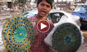 Only In India You Can Find Linguistic Master Selling Fans On The Streets
