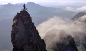 Mountain Biker With Enormous Balls, Skillfully Ascends To The Top Of A Ridge Using His Bicycle