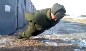 Can Anyone Explain To Me How This Russian Soldier Is Doing Push Ups With No Hands?