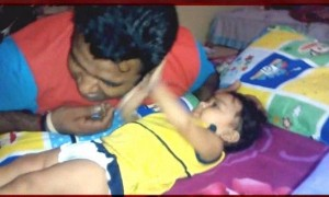 See this cute baby girl slapping father, can you count the slaps ?