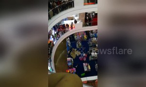 Shoppers flee in panic as mall floods following heavy rain
