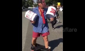 Man touts beer kegs, wears pants around ankles to poke fun at Kavanaugh during DC protests