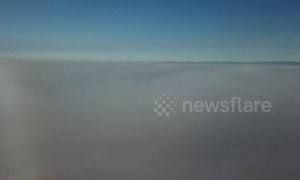 Drone camera pierces fog bank to reveal gorgeous clear sky