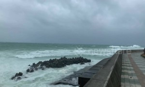 Waves crash on Okinawa beach as typhoon brings strong winds and rains to Japan's south
