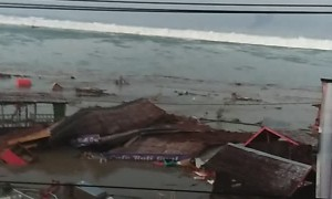 Tsunami Crashes into Indonesian City