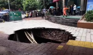 Huge sinkhole swallows up passersby on street in China