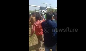 Indian farmers carry Air Force plane on shoulders after crash