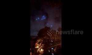 Mysterious blue lights move in flying wheel formation over Moscow