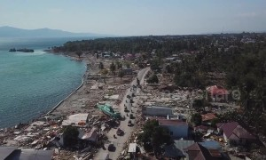 Stranded fishing boats and lone minarets: Last-ditch rescue efforts in Indonesia