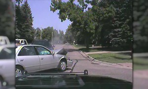 Police car gets hit by distracted driver