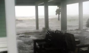 Waves break land, flooding residential area in Florida