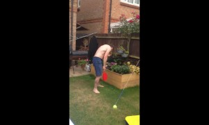 Dad get smacked in the face twice during family swingball game