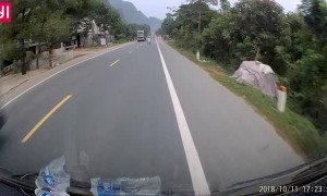 Two Trucks Avoid Clueless Pedestrian