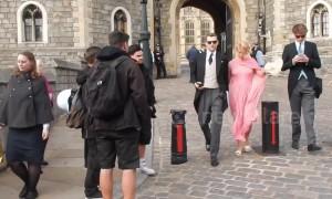 Pixie Geldof appears camera-shy as she departs royal wedding