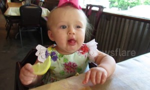 Baby eats a lemon for the first time