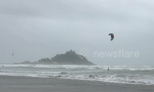 Ocean high! Kite surfers make most of gale-force winds in front of iconic St Michael's Mount
