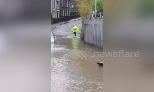 Man wades across flood because he doesn't want to extend morning run