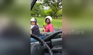 Pillion passenger wears helmet the wrong way round