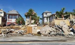Piles of debris from flattened houses lie on side of Mexico Beach roads