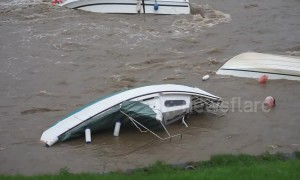 After Storm Callum: Capsized boats in Welsh harbour