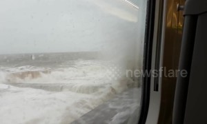 Passenger films moment Great Western train gets soaked by giant wave
