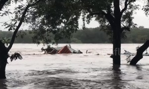 Raging floodwaters carry entire house downstream as severe flooding hits Central Texas