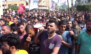 Crowds attend funeral of young Palestinian killed in Israeli strike on Gaza