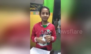 The incredible moment an Indian boy lights up a light bulb with just his bare hands
