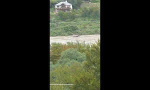 Boat dock floats down river during historic flood in Marble Falls, Texas