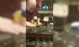 Pub-goer performs incredible trick with pint of Guinness and packet of crisps
