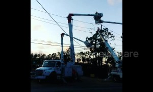 Linemen restore power in hurricane-hit Florida Panhandle as 155,000 still without