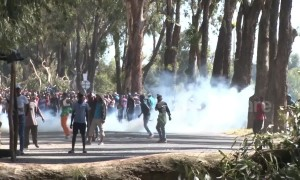 South Africans set up barricades during violent protests in Atlantis