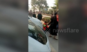 Cleaner gets beaten up after stopping boy from defecating on street