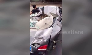 Determined driver takes flattened car to repair shop